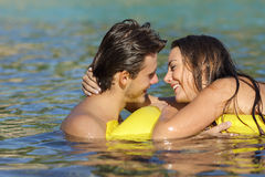 Couple kissing in summer vacation on the beach. Couple dating and kissing with love in summer vacation on the beach while bathing in the water Stock Photo