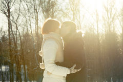 Couple kissing on sunlight backgroung in park Stock Image