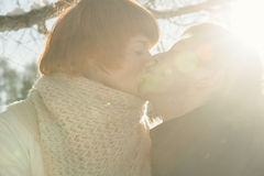 Couple kissing on sunlight backgroung. Young couple kissing on sunlight backgroung Stock Images