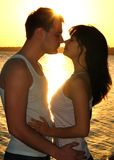 Couple kissing at sunset Royalty Free Stock Photos