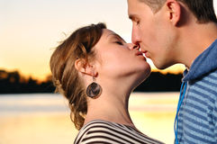 Couple is kissing at sunset Royalty Free Stock Image
