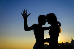 Couple kissing at sunset Stock Photos