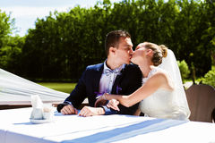 Couple kissing at the table Stock Image