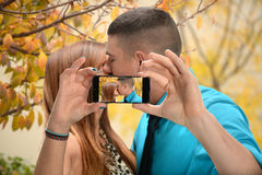 Couple Kissing While Taking Photo Royalty Free Stock Photo