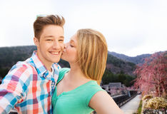 Couple kissing and taking selfie over asian town Stock Photo