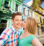 Couple kissing and taking selfie over city street. Travel, tourism, technology, love and people concept - smiling couple kissing and taking selfie over latin Stock Photography