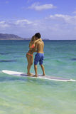Couple kissing on their paddle board Royalty Free Stock Images