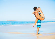 Couple Kissing on Tropical Beach. Attractive Couple Kissing on Sunny Beach Vacation Royalty Free Stock Photo