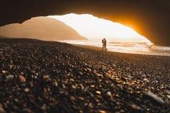 Free Couple Kissing Under Arch On Legzira Ocean Beach And Enjoying Fantastic Sunset Stock Photo - 182466350