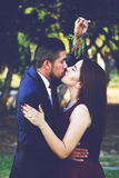 Couple kissing under branch Stock Image