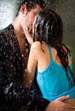 Couple kissing under a rain Royalty Free Stock Photo