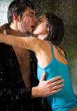 Couple kissing under a rain Stock Photo