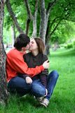 Couple kissing under a tree Stock Photography