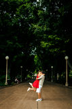Couple Kissing Under Trees Stock Image