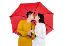 Couple kissing under umbrella Royalty Free Stock Photos