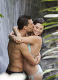 A couple kissing in a waterfall Stock Image
