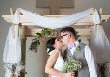 Couple Kissing on Wedding Day. At Church Stock Photography