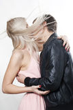 Couple kissing in the wind. Studio shot Stock Images