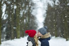 Couple kissing on winter day Stock Image