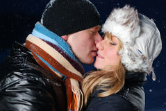 Couple is kissing at winter evening Stock Photos