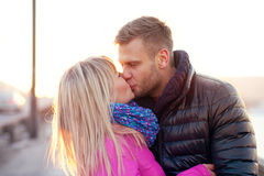 Couple kissing in winter warm clothes Royalty Free Stock Images
