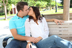 Couple Kisssing on Bench at School Royalty Free Stock Photos