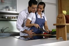 Couple in kitchen. Young attractive couple making dinner Stock Photo