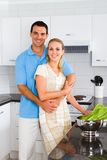 Couple in kitchen Stock Image