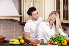 Couple on kitchen Stock Photos