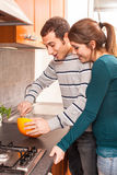 Couple in the Kitchen Stock Images