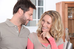 Couple in the kitchen. Couple flirting in the kitchen royalty free stock photos