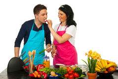 Couple in kitchen Stock Images