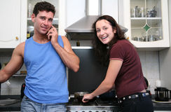 Couple on the kitchen Stock Photos