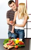 Couple at kitchen Royalty Free Stock Images