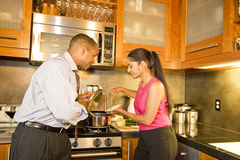 Couple in Kitchen\ Stock Images