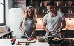 Couple on kitchen Stock Image