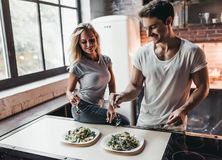 Couple on kitchen. Attractive couple is cooking on kitchen Stock Images
