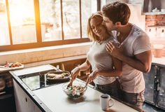 Couple on kitchen. Attractive couple is cooking on kitchen Royalty Free Stock Image