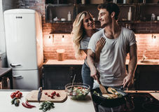 Couple on kitchen Stock Photo