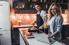 Couple on kitchen royalty free stock photos