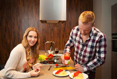 Couple in a kitchen cooking pasta Royalty Free Stock Photo