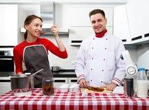 Couple at kitchen Stock Photos