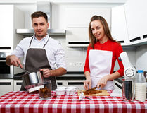Couple at kitchen Royalty Free Stock Image