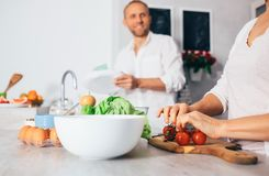 Couple on kitchen cooks together Royalty Free Stock Image