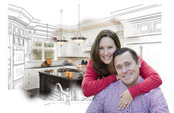 Couple With Kitchen Design Drawing and Photo Behind. Happy Couple With Kitchen Design Drawing and Photo Behind Stock Photography