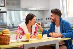 Couple in kitchen happy together stock photo