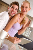 Couple in kitchen having breakfast Royalty Free Stock Image