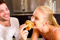 Couple in kitchen having breakfast Royalty Free Stock Image