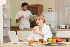 Couple in kitchen having breakfast Royalty Free Stock Photos