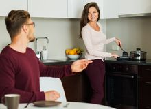 Couple on a kitchen at home Stock Images